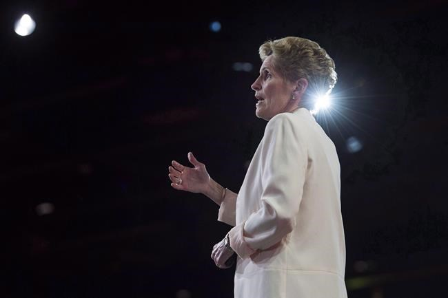 Ontario Premier Kathleen Wynne speaks during the federal Liberal national convention in Halifax on Friday, April 20, 2018. The leaders of Ontario's three main political parties will square off on the same stage for the first time Monday, just days before the official start of the province's spring election campaign. THE CANADIAN PRESS/Darren Calabrese