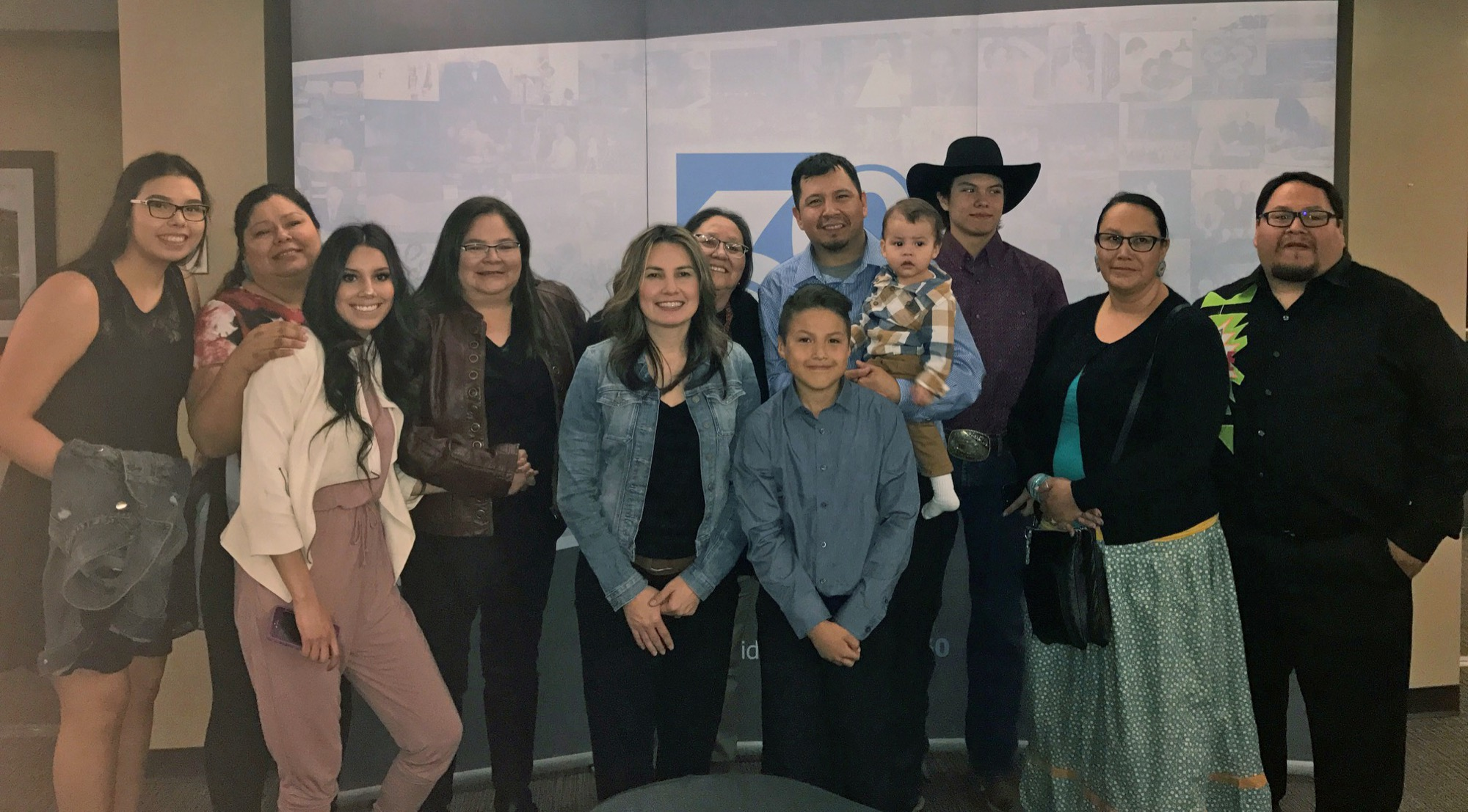 Charlton Weasel Head's family is shown (left to right): daughter Taylor, sister Zana, daughter Kirbi, sister Roana, wife Stacey, mother Gloria, son Talon, Charlton Weasel Head holding grandson Chaseton, son Bailey, sister in law Roxy and brother Lionel. (Submitted)