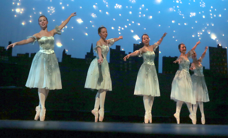 The Magical Snowflake dancers grace the stage on the starlit wintery night.  BRUCE BUMSTEAD/FOR THE SUN