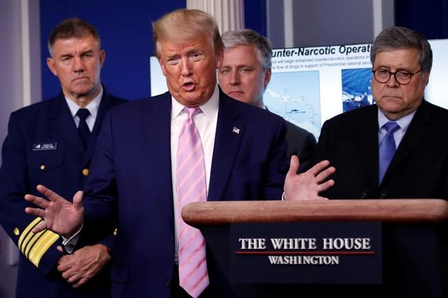 President Donald Trump speaks about the coronavirus in the James Brady Press Briefing Room of the White House, Wednesday, April 1, 2020, in Washington, as Adm. Karl Leo Schultz, commandant of the Coast Guard, national security adviser Robert O'Brien and Attorney General William Barr listen. (AP Photo/Alex Brandon)