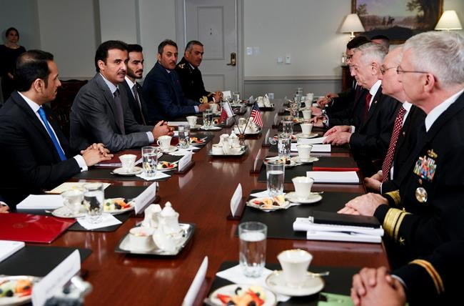 Defense Secretary Jim Mattis, third from right, and Emir of Qatar Sheikh Tamim bin Hamad al-Thani, second from left, participate in a bilateral meeting at the Pentagon, Monday, April 9, 2018. (AP Photo/Carolyn Kaster)