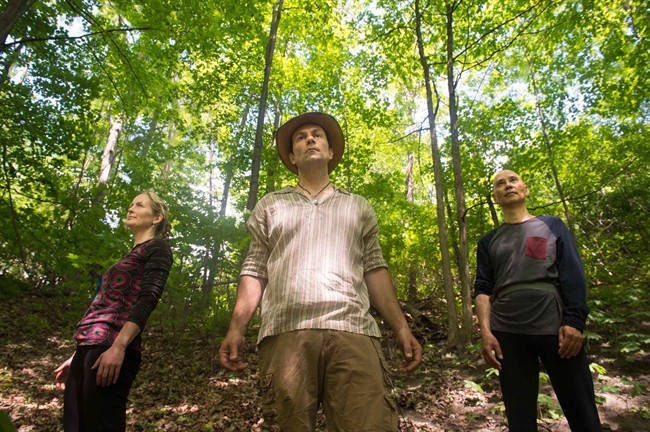 Ben Porchuk, center, head of the Canadian chapter of the Association of Nature and Forest Therapy Guides and Programs, poses with Ruthanne Henry, left, and Real Eguchi during a session of forest therapy at Sunnybrook Park, in Toronto, on Friday, June 3, 2016. It's no secret that a walk in the woods can be great for boosting your mood. But a burgeoning group of nature enthusiasts say it can do much more - including strengthen immunity, lower blood pressure, increase your ability to focus, and ultimately lower health-care costs if done regularly. THE CANADIAN PRESS/Eduardo Lima