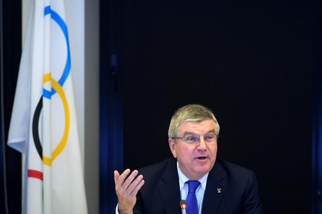 International Olympic Committee (IOC) president Thomas Bach from Germany speaks prior to the opening of the first day of the executive board meeting of the International Olympic Committee (IOC) at the IOC headquarters, in Pully near Lausanne, on Tuesday, Dec. 5, 2017. The IOC executive board is meeting to decide if Russian athletes can compete at the upcoming Pyeongchang Olympics despite evidence that the country ran an orchestrated doping program at the 2014 Sochi Games. (Laurent Gillieron/pool photo via AP)