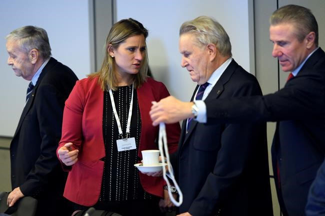 International Olympic Committee (IOC) members Denis Oswald, center right, of Switzerland, speaks with Angela Ruggiero, center left, from the United States, next to Gian-Franco Kasper, left, from Switzerland and Sergey Bubka, right, from the Ukraine, prior to the opening of the first day of the executive board meeting of the International Olympic Committee (IOC) at the IOC headquarters, in Pully near Lausanne, on Tuesday, Dec. 5, 2017. The IOC executive board is meeting to decide if Russian athletes can compete at the upcoming Pyeongchang Olympics despite evidence that the country ran an orchestrated doping program at the 2014 Sochi Games. (Laurent Gillieron/pool photo via AP)