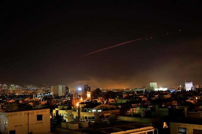 Damascus skies erupt with anti-aircraft fire as the U.S. launches an attack on Syria targeting different parts of the Syrian capital Damascus, Syria, early Saturday, April 14, 2018. Syria's capital has been rocked by loud explosions that lit up the sky with heavy smoke as U.S. President Donald Trump announced airstrikes in retaliation for the country's alleged use of chemical weapons. (AP Photo/Hassan Ammar)