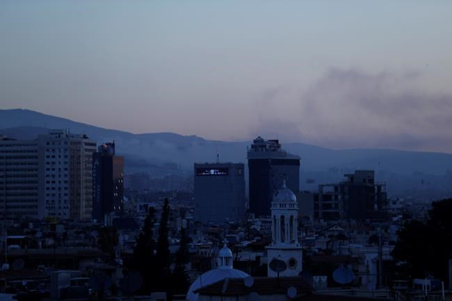 Smoke rises after airstrikes targeting different parts of the Syrian capital Damascus, Syria, early Saturday, April 14, 2018. Syria's capital has been rocked by loud explosions that lit up the sky with heavy smoke as U.S. President Donald Trump announced airstrikes in retaliation for the country's alleged use of chemical weapons. (AP Photo/Hassan Ammar)