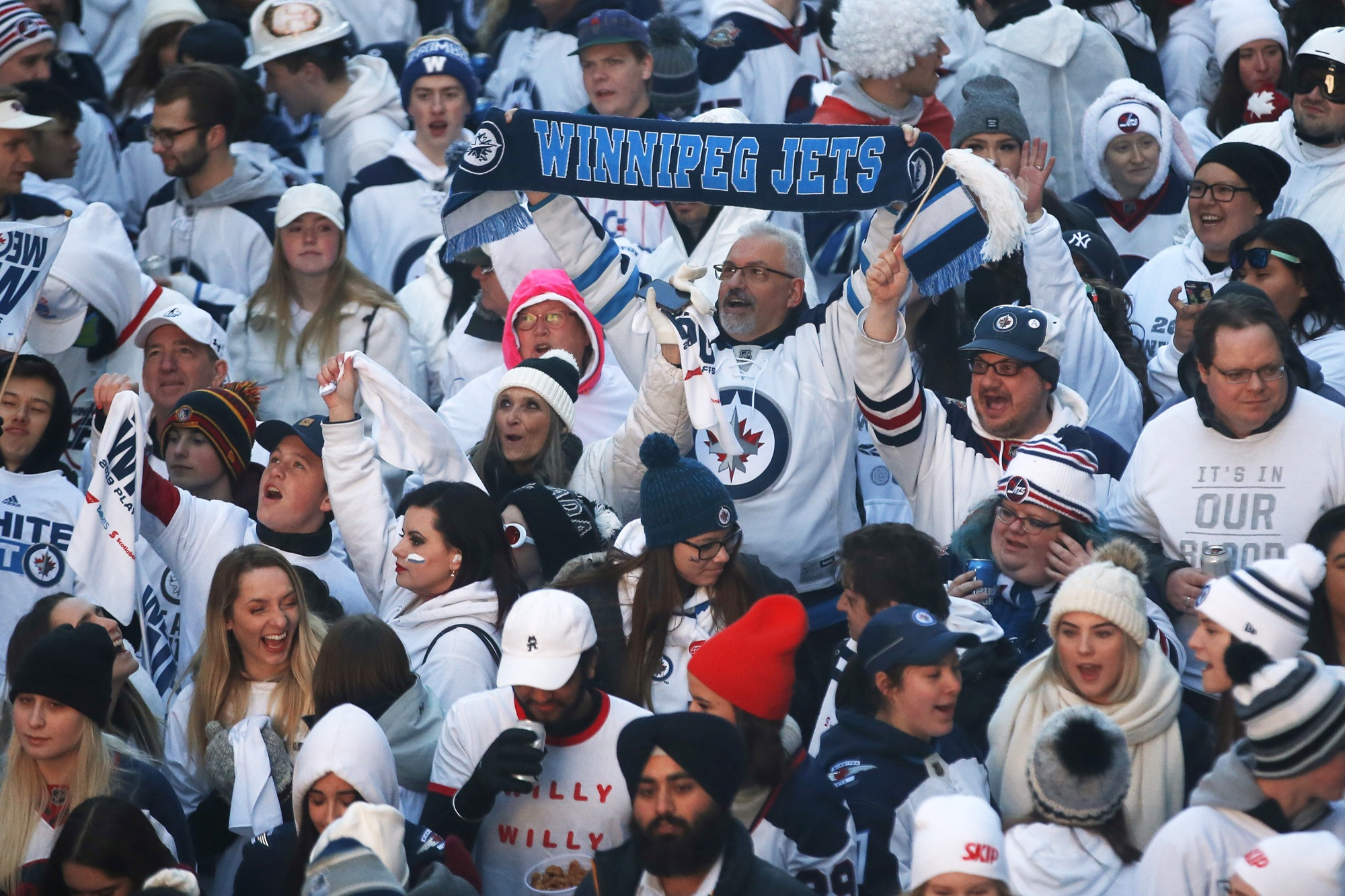 Winnipeg Jets' fans get warmed up at the Whiteout Street Party prior to the second NHL playoff game against the St. Louis Blues during in Winnipeg on Friday, April 12.
