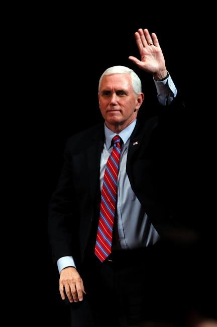 Vice President Mike Pence reacts to audience members after a roundtable with agriculture and food supply leaders about steps being taken to ensure the food supply remains secure in response to the coronavirus pandemic, Friday, May 8, 2020, in West Des Moines, Iowa. (AP Photo/Charlie Neibergall)