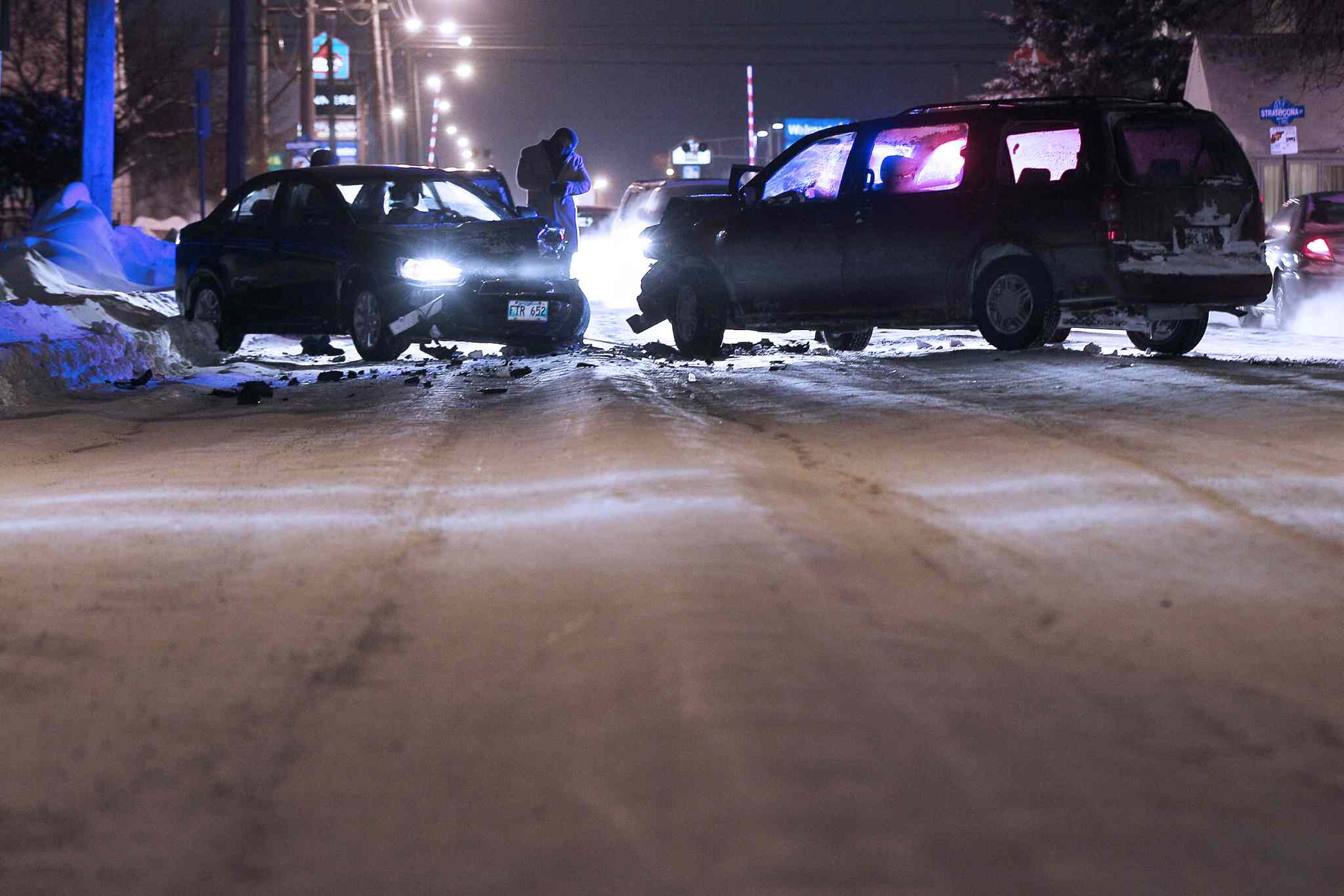 Cars collide after sliding on an icy, rutted Ellice Avenue. Manitoba Public Insurance reports that collision and injury claims were up 17 per cent in December compared to the same month last year. There have already been more than 16,000 collision claims in January.
