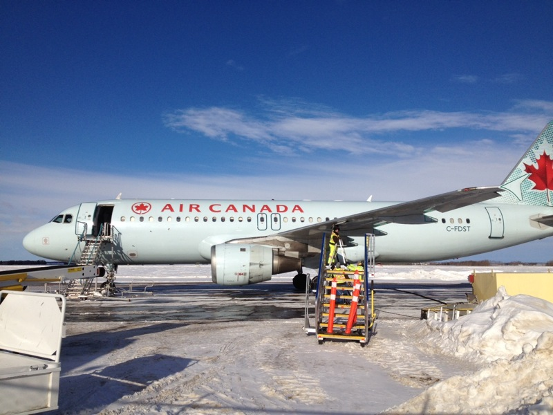 An Air Canada Airbus A320 gets refueled at McGill Field in Brandon after being diverted away from Winnipeg.