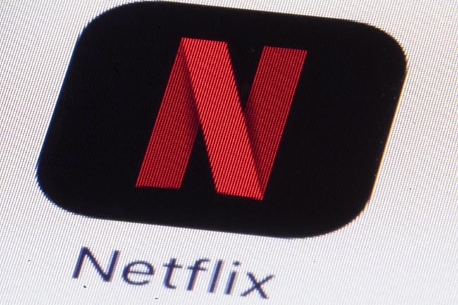 The Netflix logo is shown on an iPhone in Philadelphia on Monday, July 17, 2017. Netflix is lowering video quality for its subscribers in Canada as the streaming giant attempts to reduce soaring demands on internet bandwidth. THE CANADIAN PRESS/AP, Matt Rourke