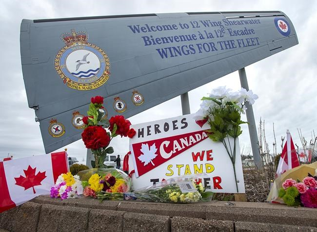 A memorial pays respect to the victims of a military helicopter crash, at 12 Wing Shearwater in Dartmouth, N.S., home of 423 Maritime Helicopter Squadron, on Friday, May 1, 2020. Officials have identified the partial remains of Capt. Brenden Ian MacDonald, the second victim to be found after last month's military helicopter crash into the Mediterranean Sea. The Department of National Defence says the Office of the Chief Coroner of Ontario used DNA to identify the partial remains, which were recovered as part of the search that followed the April 29 Cyclone crash that claimed six lives. THE CANADIAN PRESS/Andrew Vaughan