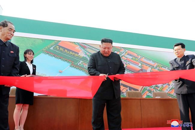 """In this Friday, May 1, 2020, photo provided by the North Korean government, North Korean leader Kim Jong Un, center, cuts a tape during his visit to a fertilizer factory in South Pyongan, near Pyongyang, North Korea. Kim made his first public appearance in 20 days as he celebrated the completion of the fertilizer factory, state media said Saturday, May 2, 2020, ending an absence that had triggered global rumors that he may be seriously ill. Independent journalists were not given access to cover the event depicted in this image distributed by the North Korean government. The content of this image is as provided and cannot be independently verified. Korean language watermark on image as provided by source reads: """"KCNA"""" which is the abbreviation for Korean Central News Agency. (Korean Central News Agency/Korea News Service via AP)"""