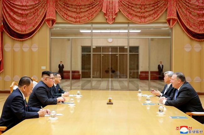 "In this Wednesday, May 9, 2018, photo provided on Thursday, May 10, 2018, by the North Korean government, U.S. Secretary of State Mike Pompeo, right, attends a meeting with North Korean leader Kim Jong Un, second from left, at the Workers' Party of Korea headquarters in Pyongyang, North Korea. Independent journalists were not given access to cover the event depicted in this image distributed by the North Korean government. The content of this image is as provided and cannot be independently verified. Korean language watermark on image as provided by source reads: ""KCNA"" which is the abbreviation for Korean Central News Agency. (Korean Central News Agency/Korea News Service via AP)"