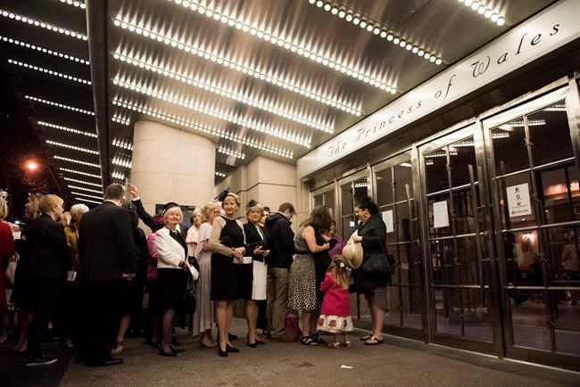 People line up to watch the Royal Wedding between Prince Harry and Meghan Markle at the Princess of Wales Theatre, in Toronto on Saturday, May 19, 2018. THE CANADIAN PRESS/Marta Iwanek