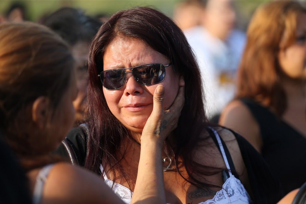 Tina Fontaine attends a vigil in honour of her daughter, Tina Fontaine, and Faron Hall at Alexander Docks in Winnipeg on Tuesday.  (Trevor Hagan / The Canadian Press )
