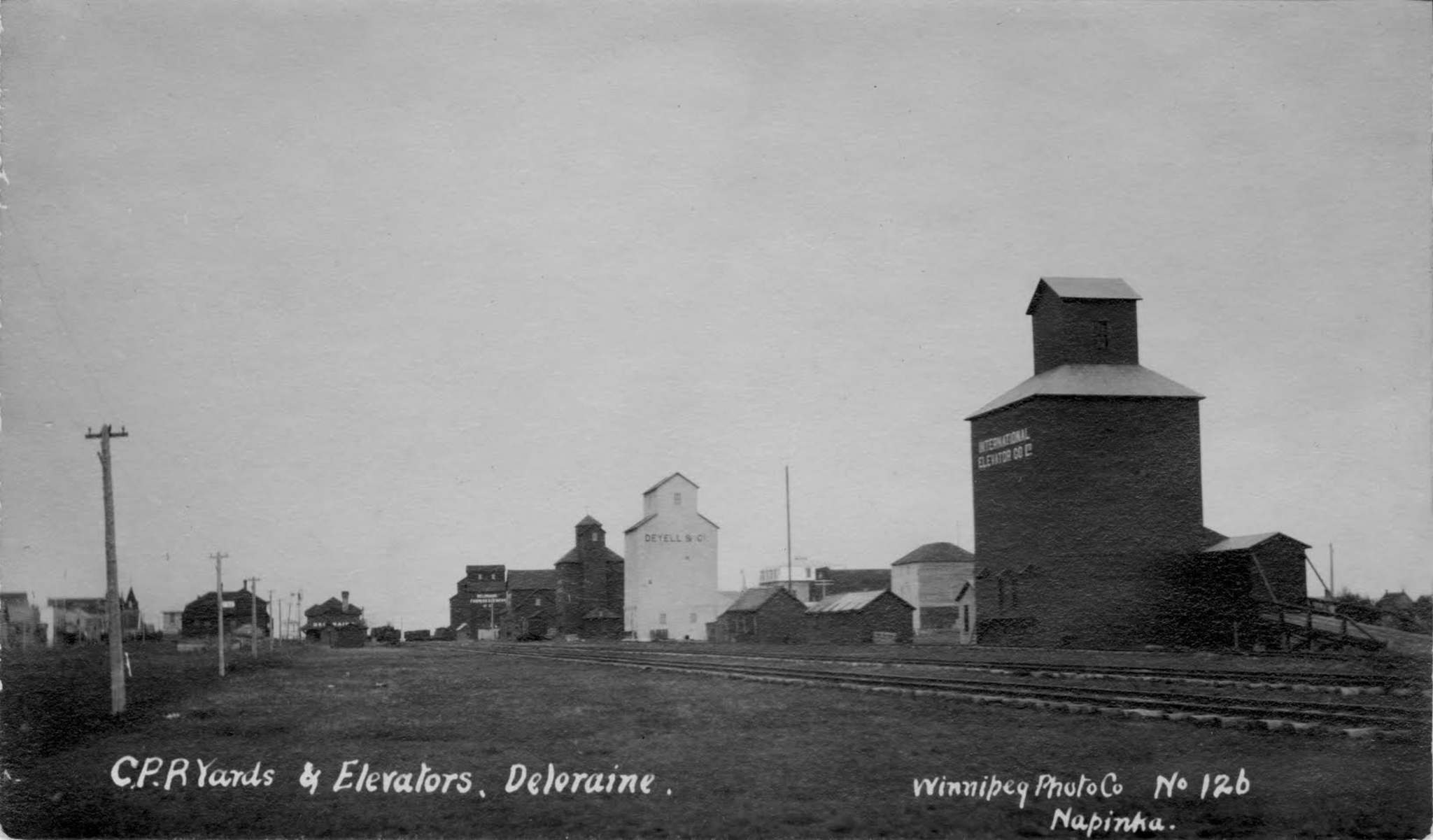 A view of Deloraine's many historic grain elevators, as they were seen along the community's main stretch in 1905. These structures no longer stand. (Submitted)</p></p>