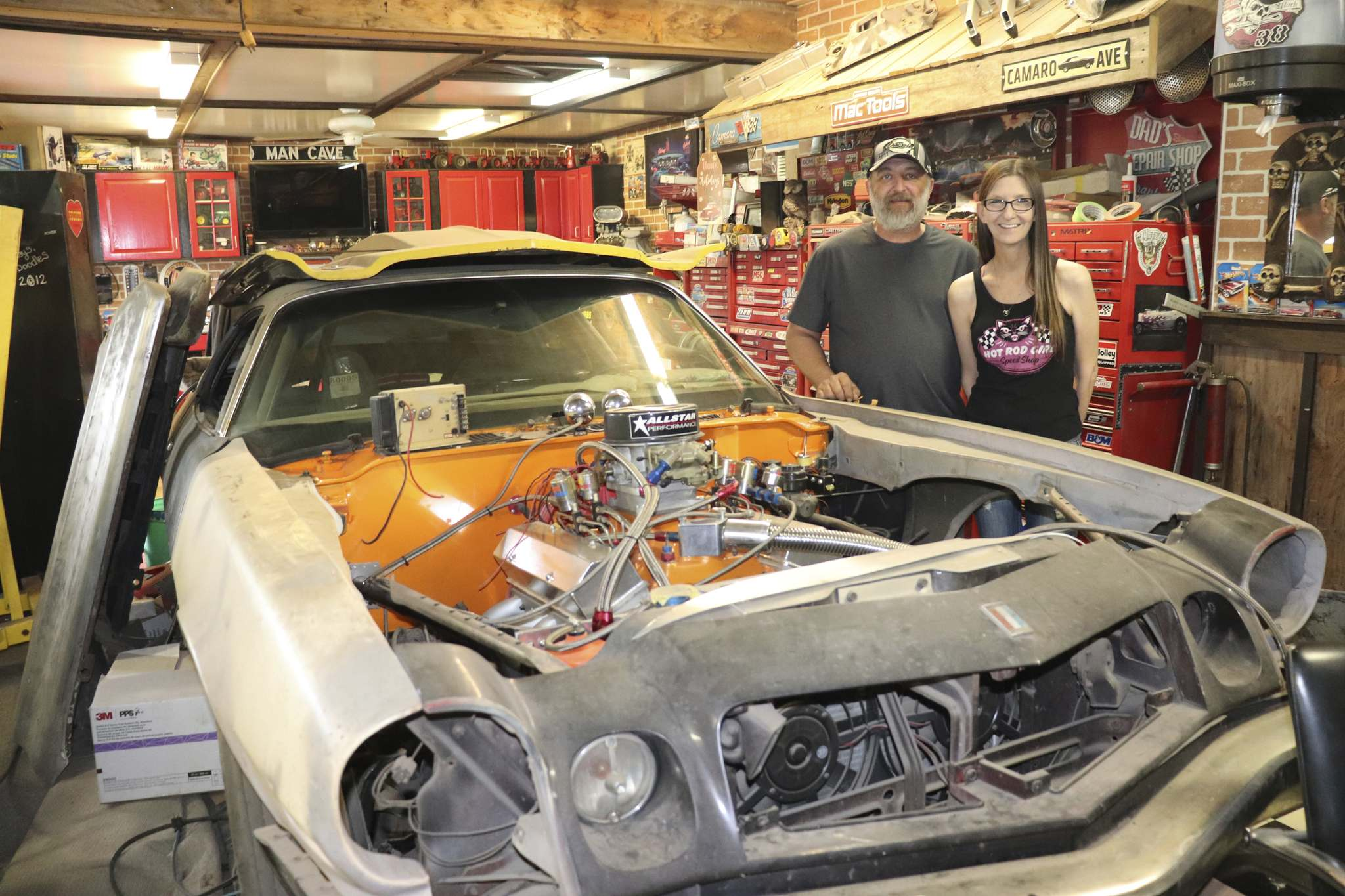 Kevin Suppes and his wife Jenifer pose for a photo next to a 1975 Chevrolet Camaro on Tuesday evening inside their garage in Cottonwoods. Suppes told the Sun that he has been working on this vehicle for around a decade and still hopes to turn it into a bona fide race car this summer. (Kyle Darbyson/The Brandon Sun)</p></p>