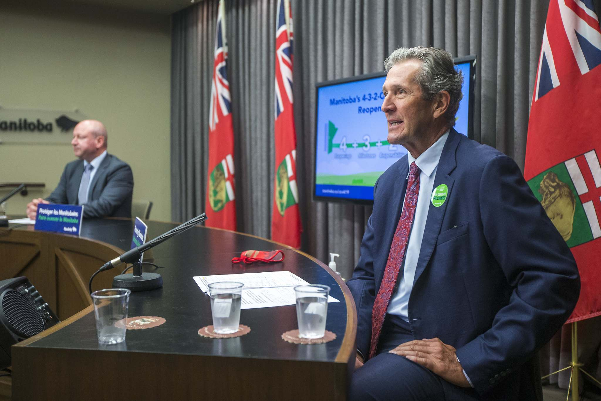Premier Brian Pallister, right, and Dr. Brent Roussin, chief provincial public health officer, outline the summer reopening plan at the Manitoba Legislative Building in Winnipeg on Thursday. (Winnipeg Free Press)</p></p>