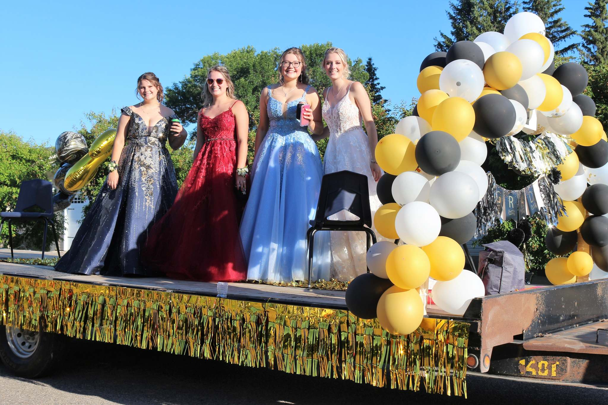 Zara Dickson, Annika Duguay, Jayde Nakonechny and Payton Dickson are seen during Carberry Collegiate's graduation parade. (Submitted)</p></p>