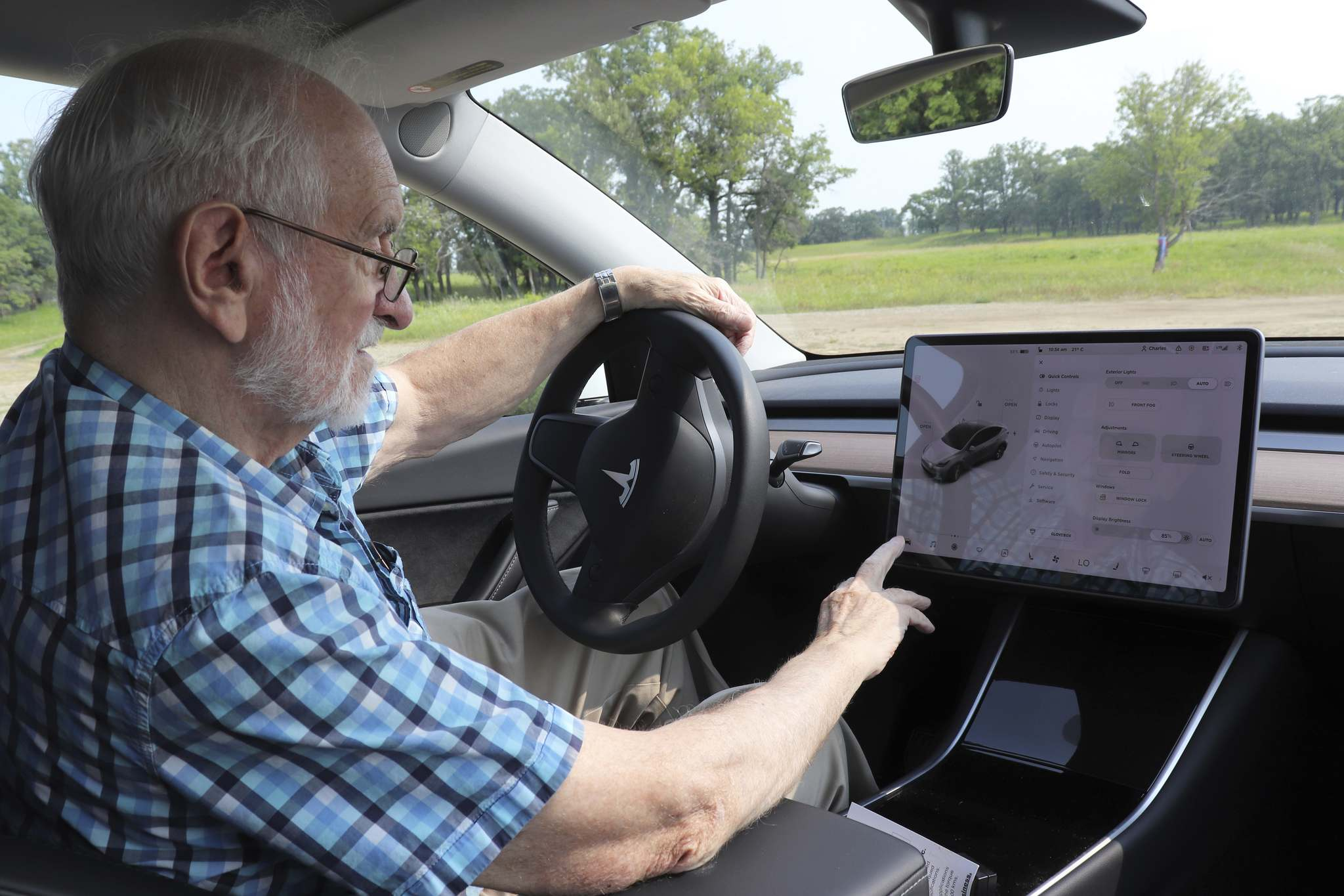 Charles Norman demonstrates the touch-screen computer controls in his Tesla. (Kyle Darbyson/The Brandon Sun)