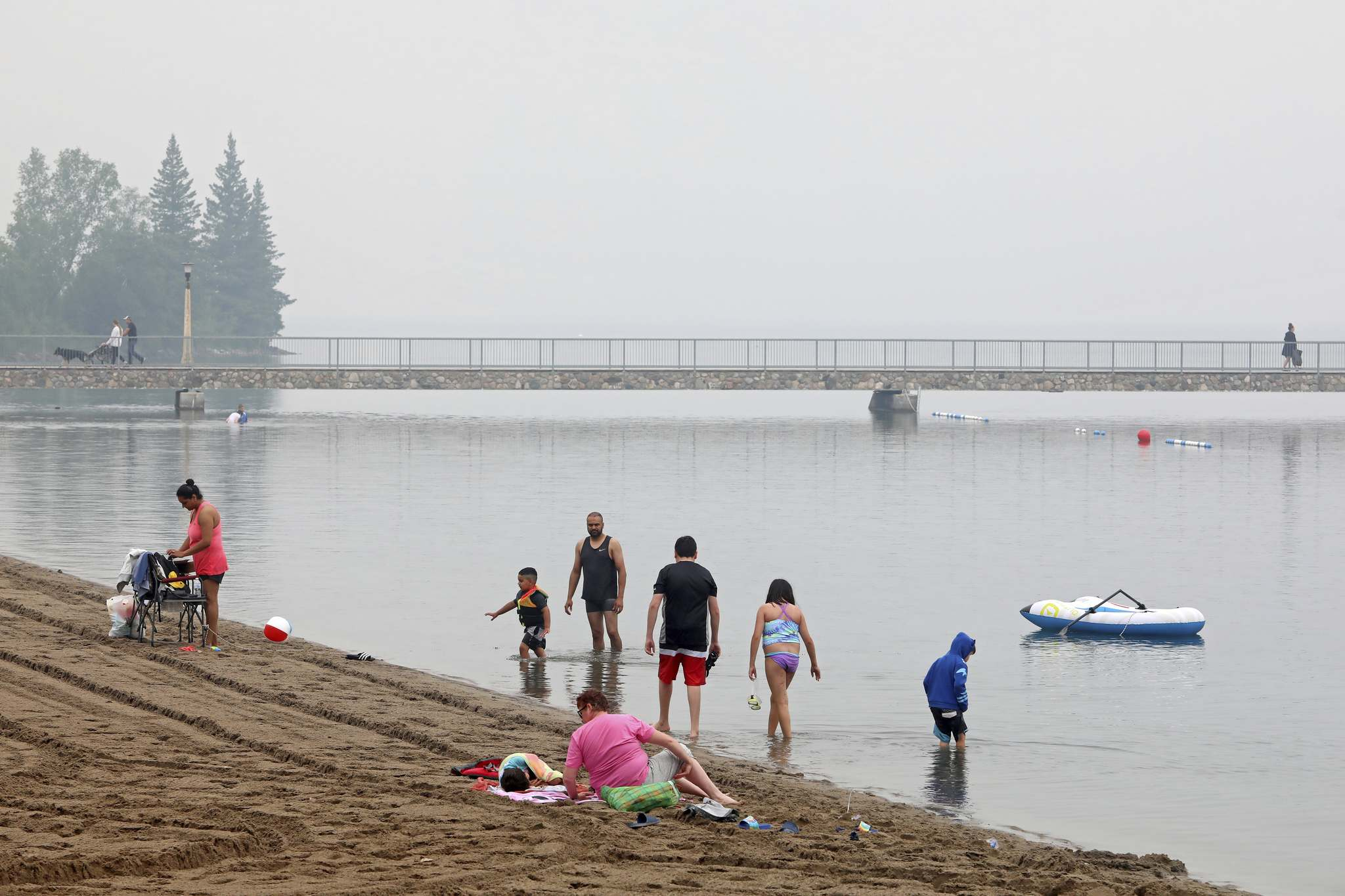 The beach in Wasagaming was sparsely populated on a drizzly Tuesday as heavy smoke from forest fires drove down temperatures in southern Manitoba. (Photos by Tim Smith/The Brandon Sun)