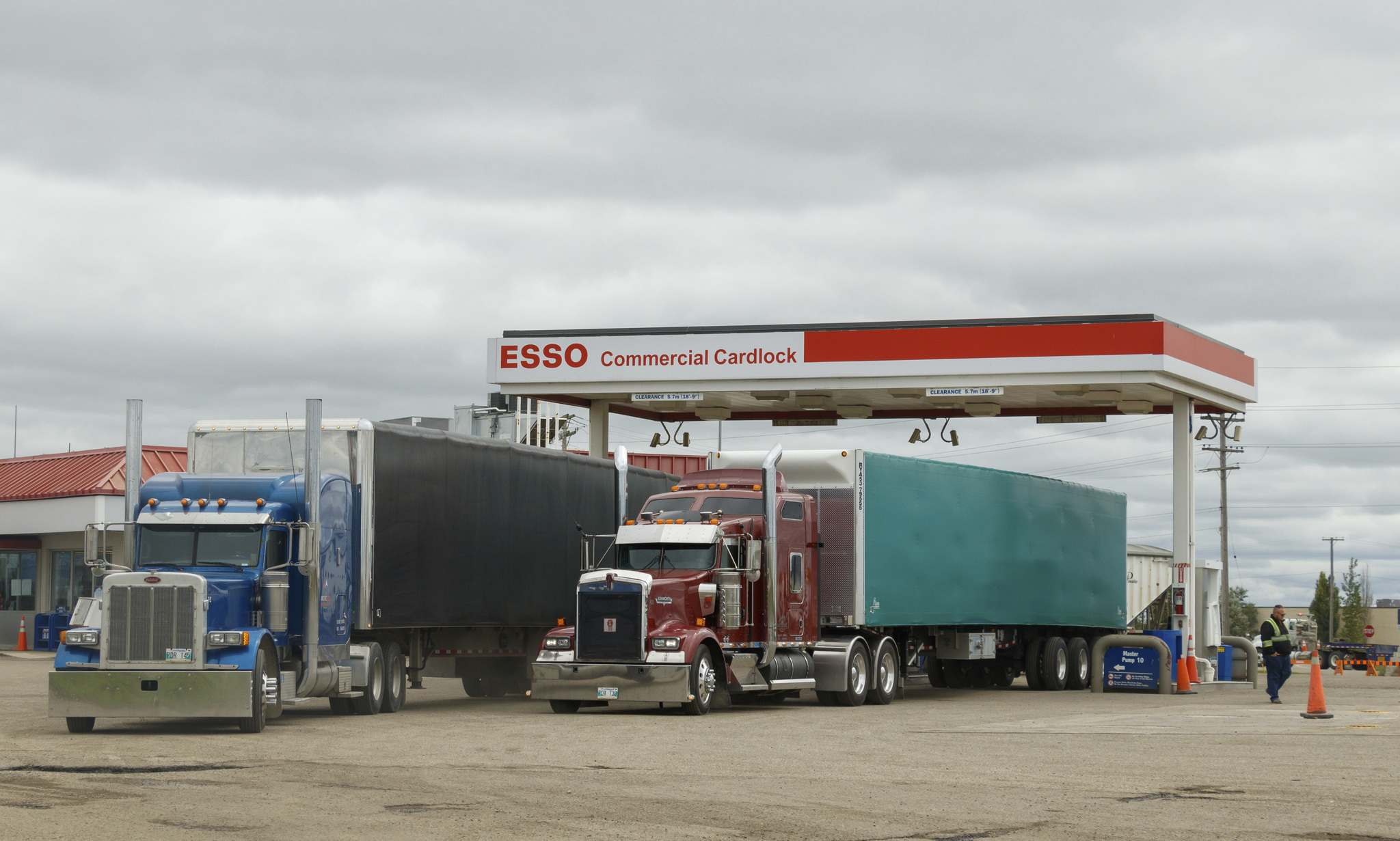 Semis pull up to the Esso Commercial Cardlock on Highway One in this file image. (FILE/The Brandon Sun)</p>