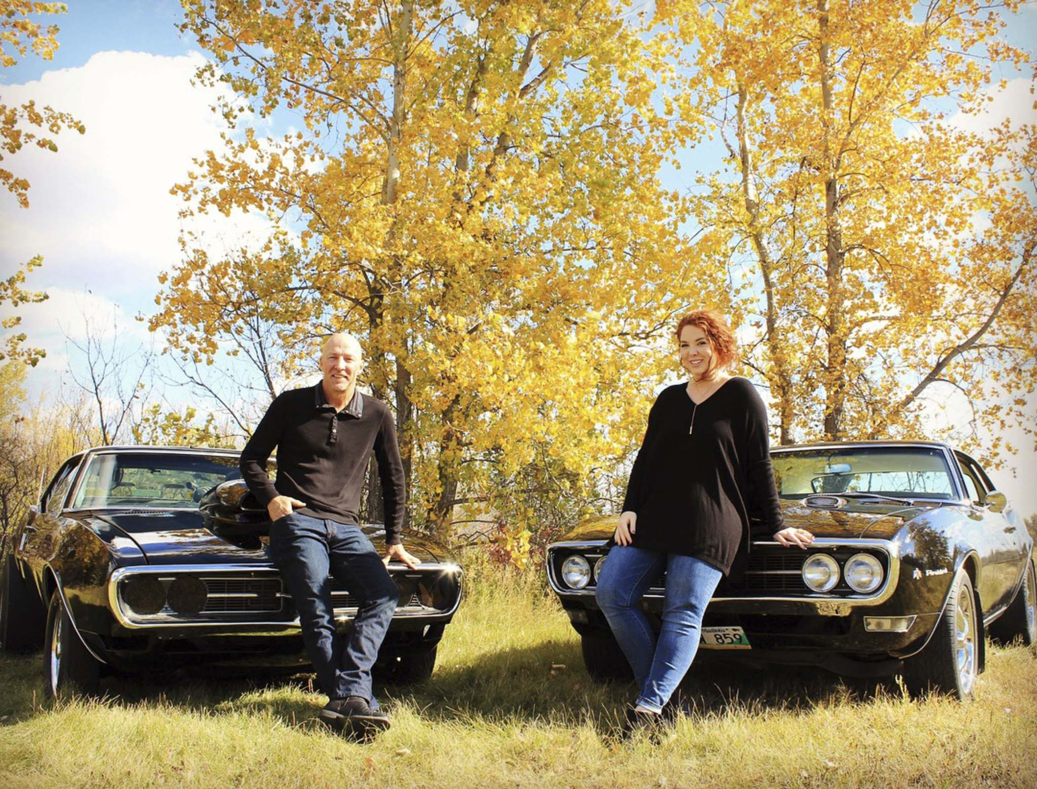 Murray and JaysaLee Davies pose for a photo with their 1968 Pontiac Firebirds near Virden circa 2014. (Submitted)</p></p>