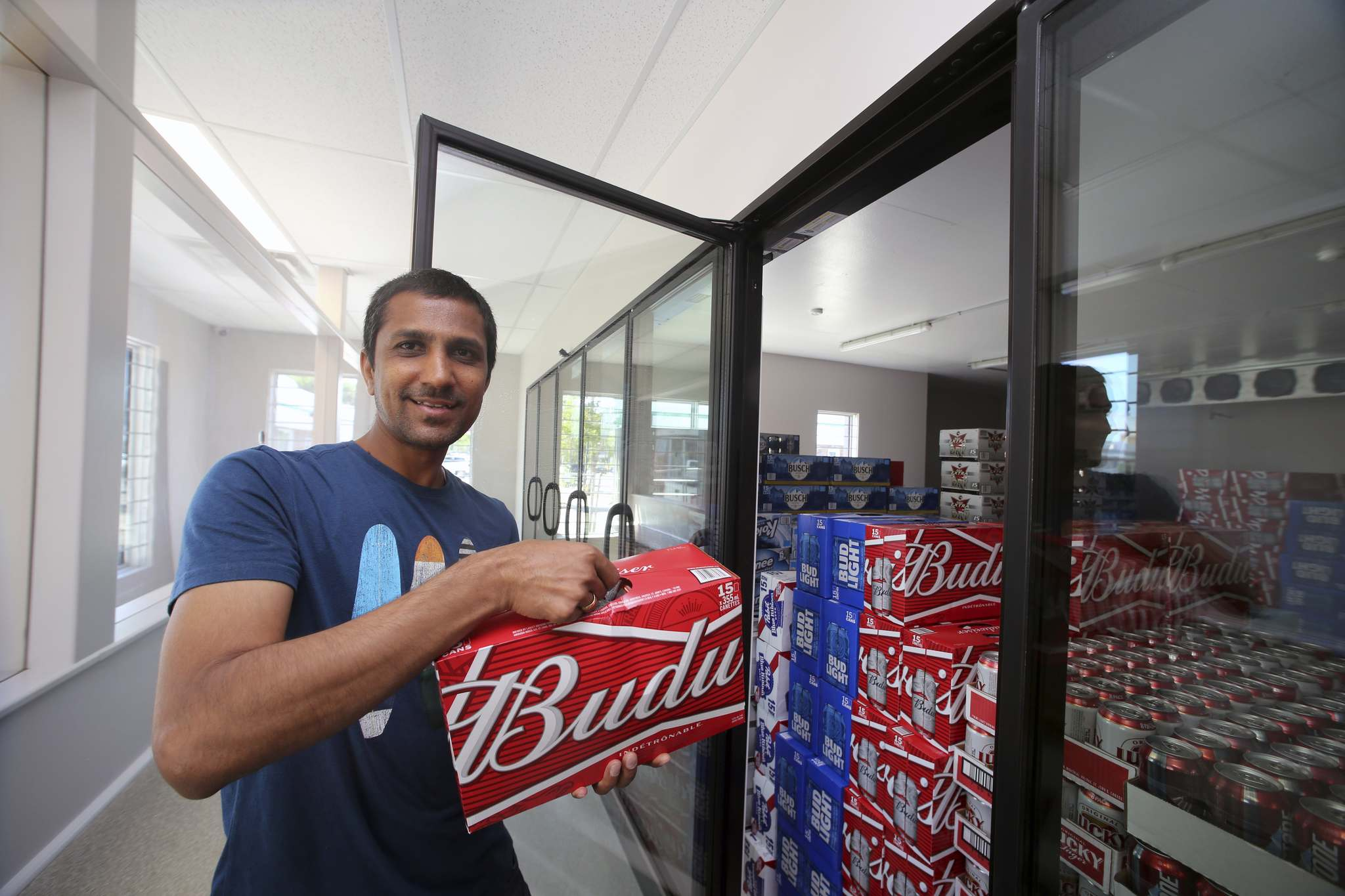 Manager Hamul Patel shows off the cooler in the rebuilt Empire Inn cold beer store on Rosser Avenue. The original beer vendor burned down in the May 2018 downtown fire. (Colin Slark/The Brandon Sun)</p></p>