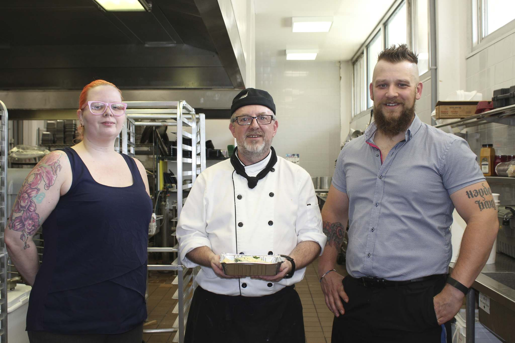 Brandon University culinary assistant Trish Chalanchuk, lead cook Paul Mount and food services manager Nicholas Namespetra are seen at the Brandon University kitchen last month. (File)</p></p>