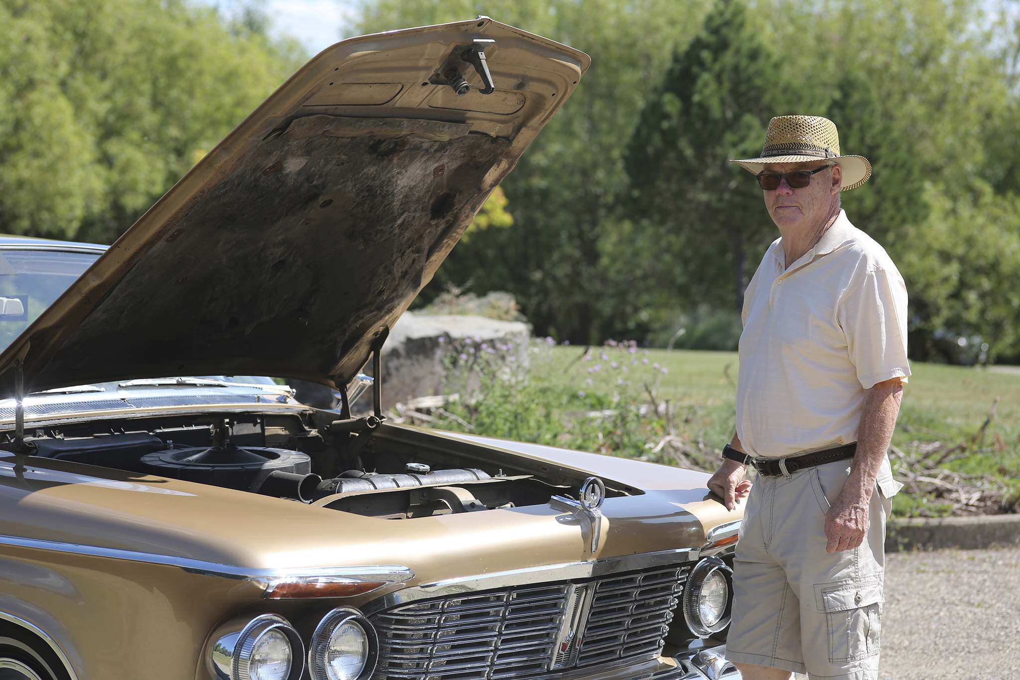 Reg Atkinson checks out the 413-cubic-inch engine that powers his 1963 Chrysler Imperial. (Kyle Darbyson/The Brandon Sun)