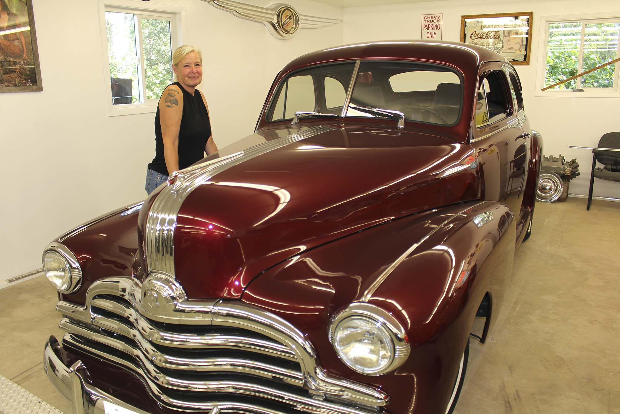 Jean Chopp poses next to a 1947 Pontiac Business Man's Coupe this past Tuesday in the RM of Rosedale. Chopp is responsible for maintaing some of her husband's classic cars when it comes to their upholstery and paint jobs. (Kyle Darbyson/The Brandon Sun)