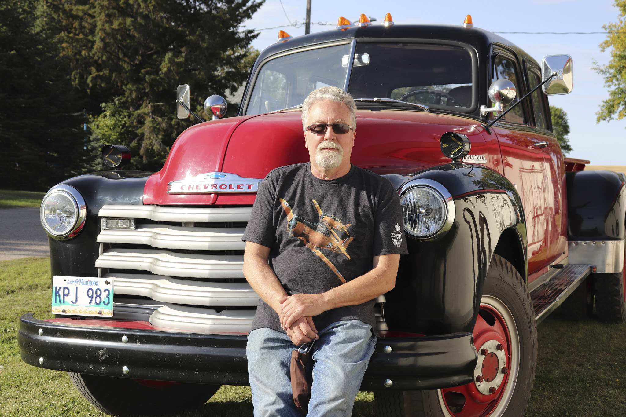 Commonwealth Air Training Plan Museum president John McNarry sits on the bumper of his custom 1953 Chevrolet truck this past Saturday in Alexander. Before McNarry's restoration, this vehicle was used to fight fires in McCreary. (Kyle Darbyson/The Brandon Sun)