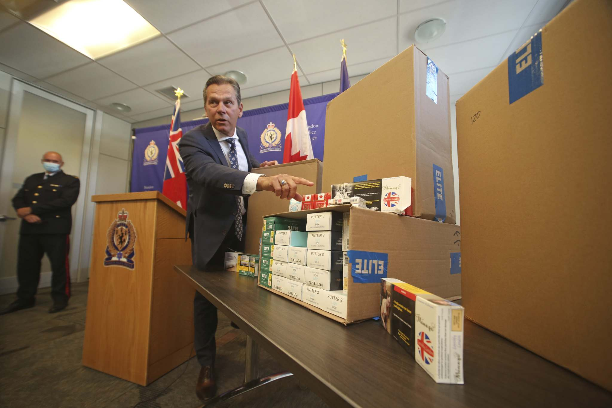 Ron Bell, supervisor of the Manitoba Taxation, Special Investigations Unit, points to one of the brands of contraband cigarettes seized by the Brandon Police Service through a partnership with the Manitoba and Ontario provincial governments.</p><p>(Matt Goerzen/The Brandon Sun)</p></p>
