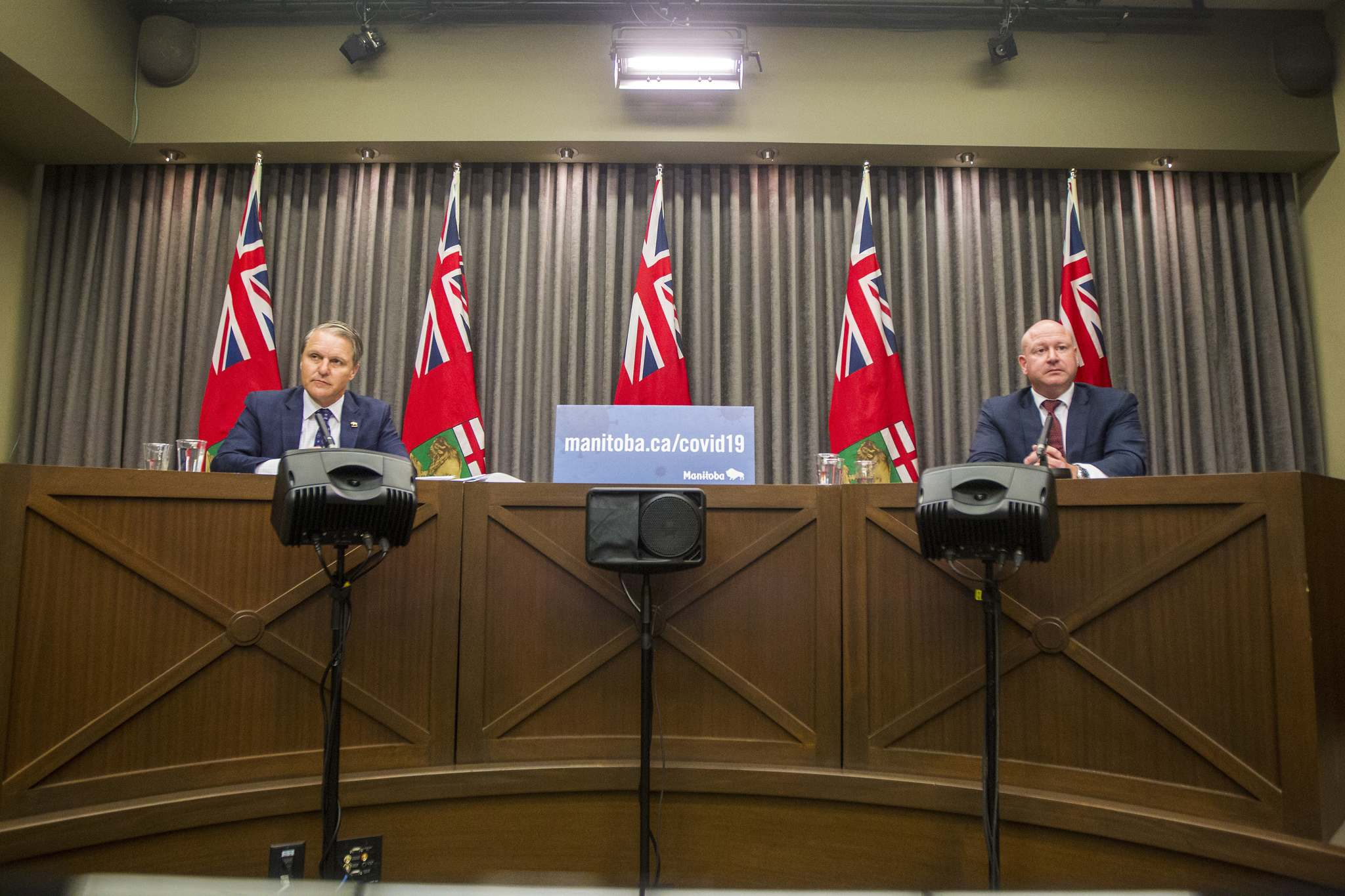 Chief public health officer Dr. Brent Roussin and Health, Seniors and Active Living Minister Cameron Friesen speak to the media at the Manitoba Legislative Building in Winnipeg on Monday. (Winnipeg Free Press)</p></p>