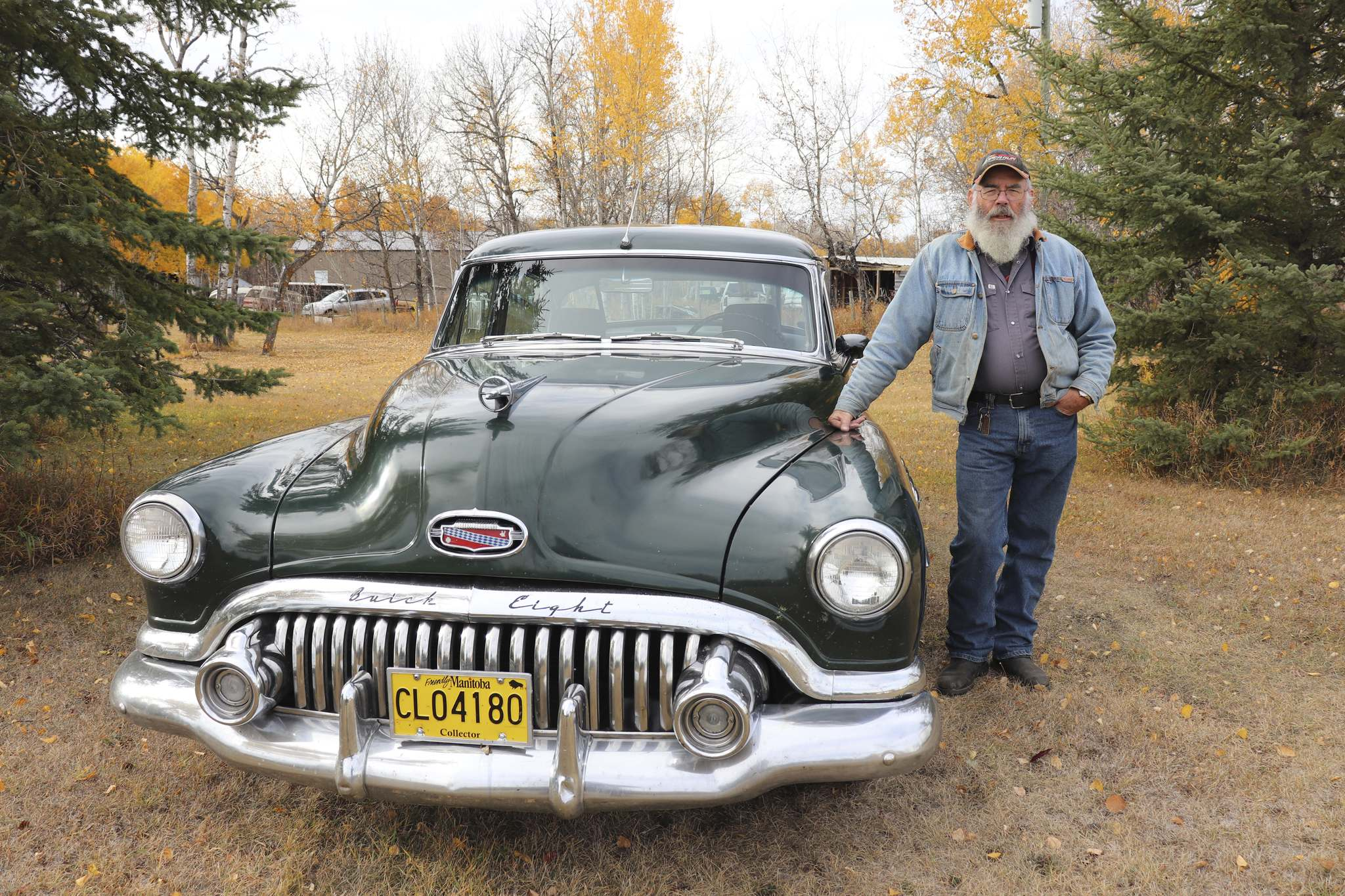 Jim Stewart poses for a photo next to his 1952 Buick Roadmaster this past Monday in the Rural Municipality of Whitehead. (Photos by Kyle Darbyson/The Brandon Sun)</p></p>