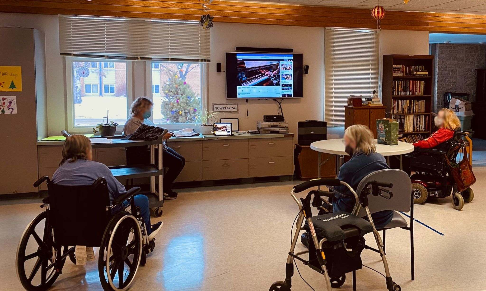 Residents at Luther Home in Winnipeg enjoy a physically-distanced viewing of a piano recital themed Home for the Holidays to complement their Ukrainian Christmas festivities, at test run of Sharing is Caring, thanks to piano teacher Corey Francis and his students Jan. 7. (Submitted)</p></p>