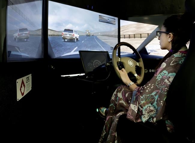 In this June 23, 2018 photo, a Saudi student practices on a driving simulator at the Saudi Driving School inside Princess Nora University in Saudi Arabia. (AP Photo/Nariman El-Mofty)