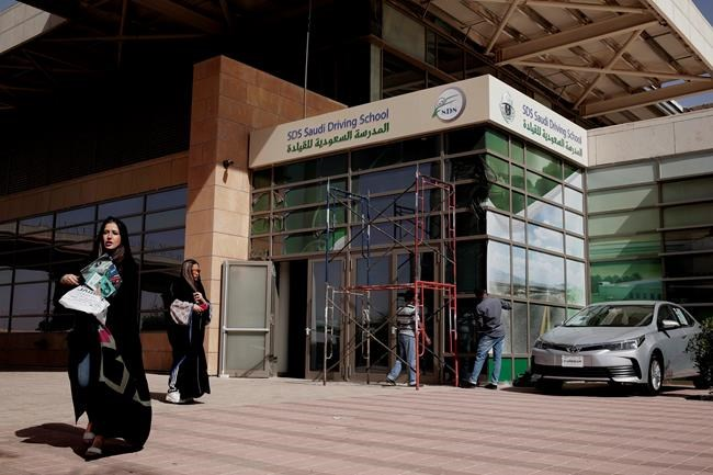 In this June 23, 2018 photo, women leave the Saudi Driving School inside Princess Nora University in Riyadh, Saudi Arabia. Saudi women are on the roads and steering their way through busy city streets freely for the first time after years of risking arrest if they dared to get behind the wheel. (AP Photo/Nariman El-Mofty)
