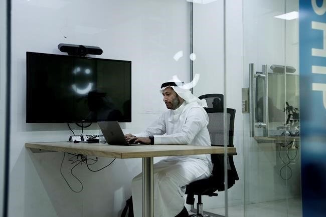 In this Sunday, June 24, 2018 photo, Careem co-founder Abdullah Elyas sits at a desk at the Careem office, in Riyadh, Saudi Arabia. Ride-hailing companies Uber and local competitor Careem are hiring female drivers after Saudi Arabia lifted a longstanding ban on women driving. It's the latest job opening for Saudi women that had been reserved for men only and one that sharply challenges traditional norms. (AP Photo/Nariman El-Mofty)