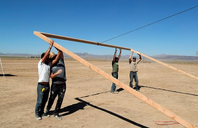 """Workers erect a stage at the Little A'Le'Inn on Wednesday, Sept. 18, 2019, in Rachel, Nev. No one knows what to expect, but lots of people are preparing for """"Storm Area 51"""" in the Nevada desert. Events include an """"Area 51 Basecamp"""" in Hiko featuring music, speakers and movies and dueling """"Alienstock"""" festivals. One is Thursday through Sunday in Rachel, and another is Thursday in Las Vegas. (AP Photo/John Locher)"""