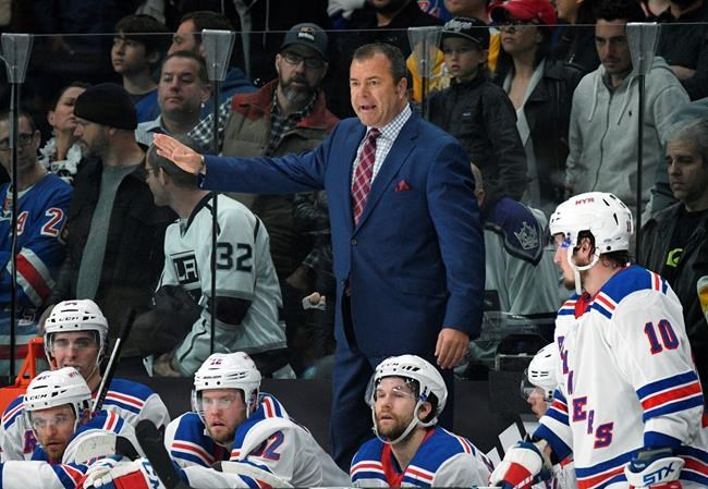 Rangers assistants follow Alain Vigneault out the door