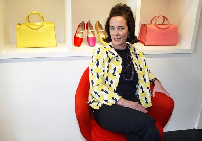 FILE - In this May 13, 2004, file photo, designer Kate Spade sits during an interview in New York. New York City's chief medical examiner ruled Spade's death a suicide by hanging. The determination was released Thursday, June 7, 2018, two days after Spade was found dead in her Park Avenue apartment. (AP Photo/Bebeto Matthews, File)