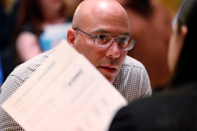 In this Tuesday, June 4, 2019 photo, job applicant Juan Ramon Velazquez answers questions as he is called up at the Seminole Hard Rock Hotel & Casino Hollywood during a job fair in Hollywood, Fla. On Friday, June 7, the U.S. government issues the May jobs report. (AP Photo/Wilfredo Lee)