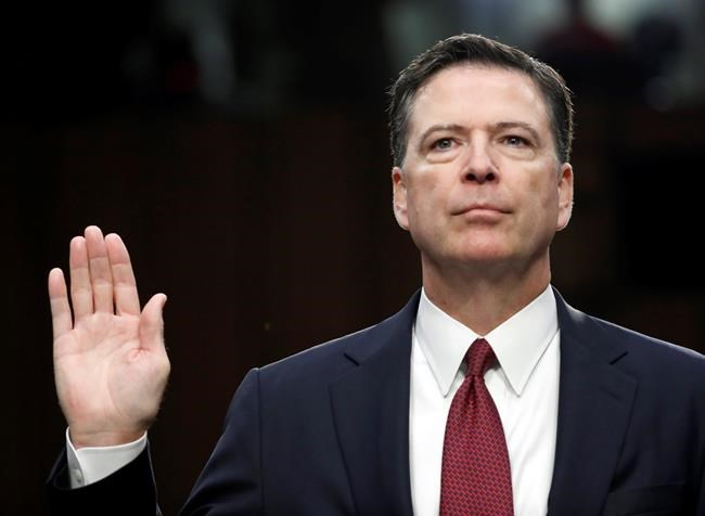 THE ASSOCIATED PRESS FILES In this June 8, 2017 file photo, former FBI Director James Comey is sworn in during a Senate Intelligence Committee hearing on Capitol Hill in Washington.