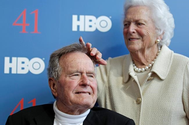 2012 file photo, former first lady Barbara Bush touches the hair of her husband, former President George H.W. Bush, as they arrive for the premiere of HBO's new documentary on his life near the family compound in Kennebunkport, Maine.