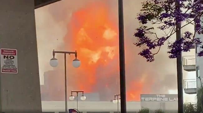 In this screen grab from video provided by Sean Miura, flames from an explosion are seen Saturday, May 16, 2020, in Los Angeles. (Sean Miura via AP)