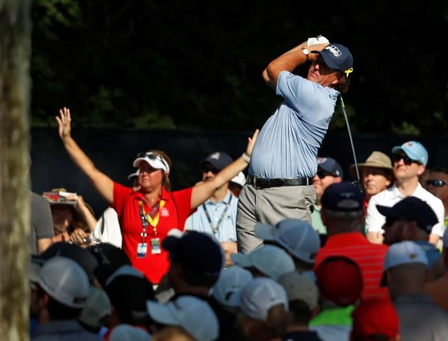 Phil Mickelson tees off on the 15th hole during the first round of the PGA Championship golf tournament at Bellerive Country Club, Thursday, Aug. 9, 2018, in St. Louis. (AP Photo/Jeff Roberson)