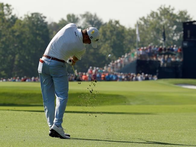 Justin Thomas hits from the 14th fairway during the first round of the PGA Championship golf tournament at Bellerive Country Club, Thursday, Aug. 9, 2018, in St. Louis. (AP Photo/Charlie Riedel)