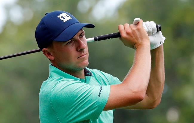 Jordan Spieth watches his tee shot on the 15th hole during a practice round for the PGA Championship golf tournament at Bellerive Country Club, Wednesday, Aug. 8, 2018, in St. Louis. (AP Photo/Jeff Roberson)